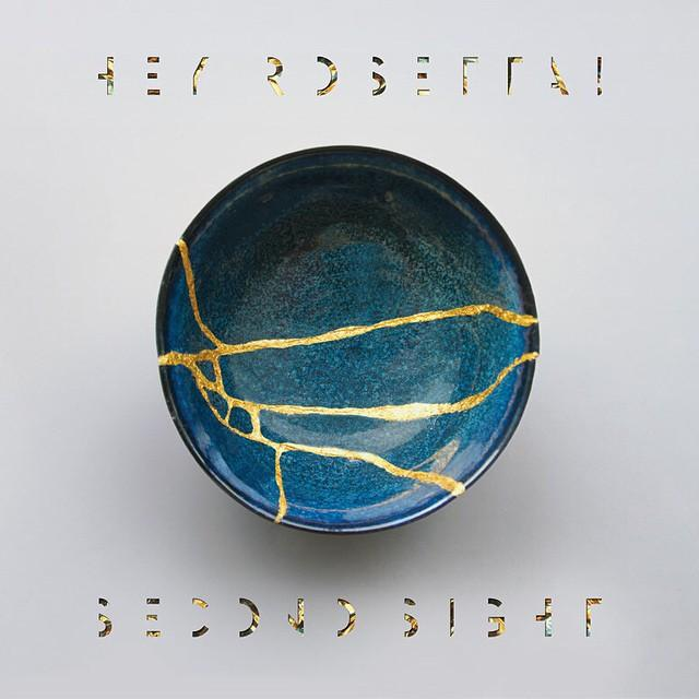 """The cover art for """"Second Sight""""  illustrates the meaning of the title of their song """"Kintsukuroi,"""" the Japanese technique of mending broken vessels with gold, and that the vessels are even stronger after they've been broken."""